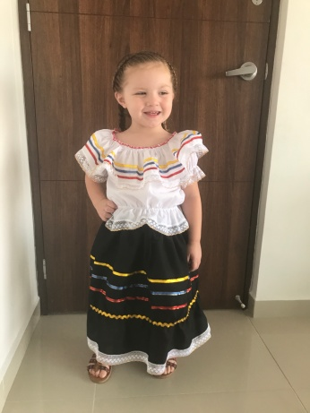 Bella in her traditional dress with her hair braided